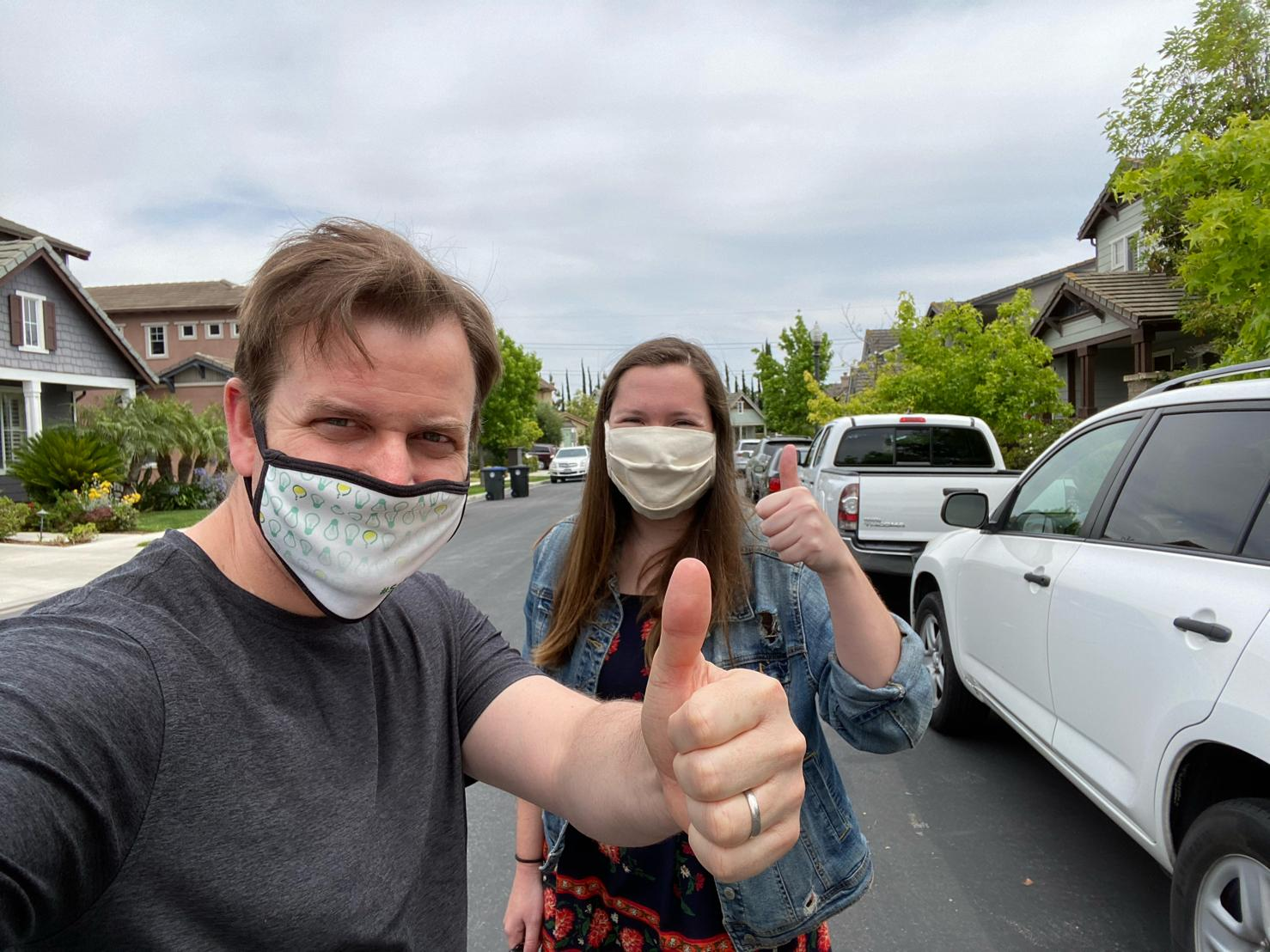 Ryder Todd Smith and Clare Burgess wearing face masks and giving the signature Tripepi Smith thumbs up.